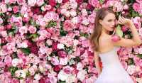 Natalie Portman between roses
